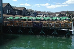 Fish House Grill :: Enjoy delicious seafood with the Fish House Grill! Various lovely assortments of meals available with their lunch and dinner menus! On the waterfront!