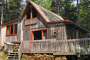 Hutchins Cottages at Acadia :: 6 rustic cottages on a wooded ridge above the village of Southwest Harbor. 5 minute walk to shops, post office, library, restaurants, playground, & Island Explorer Bus Stop.
